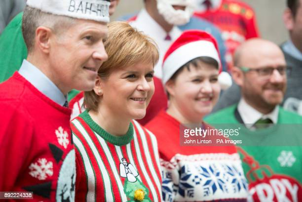 Leaders of the Scottish political parties Willie Rennie Nicola Sturgeon Ruth Davidson and Patrick Harvey wear their Christmas jumpers at a photocall...