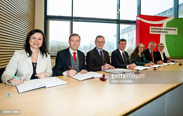 Leaders of the Thuringia German Social Democrats Greens Party and the leftist Die Linke arrive to sign the coalition contract between the three...