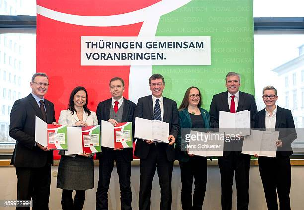 Leaders of the Thuringia German Social Democrats Greens Party and the leftist Die Linke pose for a photo after the signing the coalition contract...