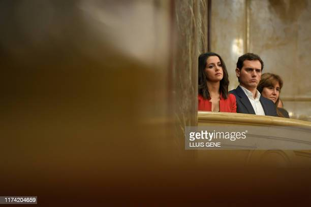 Leaders of the unionist party Ciudadanos Albert Rivera and Ines Arrimadas attend from the visitors gallery of the Catalan parliament in Barcelona a...