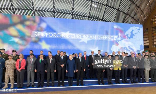 EU leaders pose for a ceremony on the Permanent Structure Cooperation on the margin of an European Council in the Europa the EU Council headquarter...
