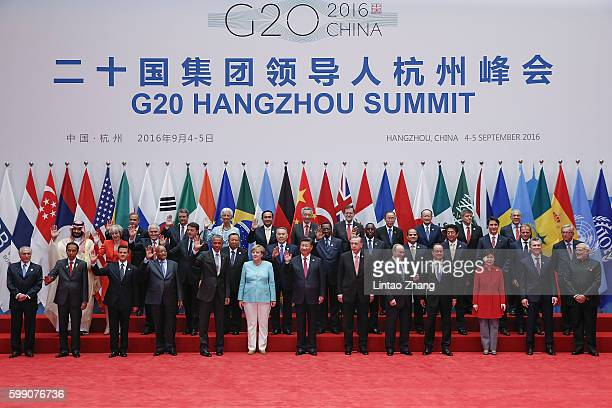 Leaders pose for a group photo during the G20 Summit in Hangzhou on September 4 2016 in Hangzhou China World leaders are gathering in Hangzhou for...