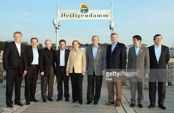 Leaders pose for a group photograph on a sea front pier British Prime Minister Tony Blair, Italian Prime Minister Romano Prodi, Russian President...