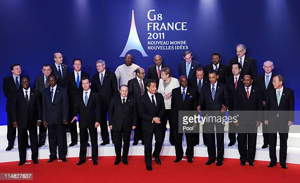 G8 leaders pose for the family photo at the G8 summit on May 27 2011 in Deauville France The Tunisian Prime Minister Beji Caid el Sebsi and Egyptian...