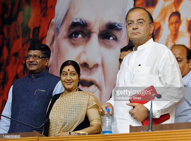BJP leaders Ravi Shanker Prasad Sushma Swaraj and Arun Jaitley attend a press conference at the party headquarters on June 21 2012 in New Delhi India...