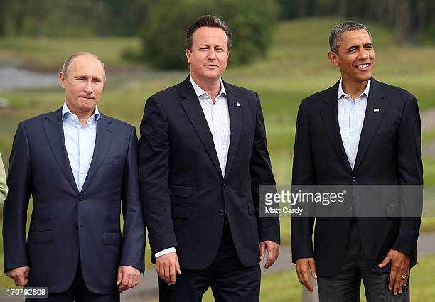 Leaders Russia's President Vladimir Putin Britain's Prime Minister David Cameron and US President Barack Obama stand for the 'family' group...