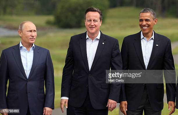 Leaders Russia's President Vladimir Putin Britain's Prime Minister David Cameron US President Barack Obama stand for the 'family' group photograph at...