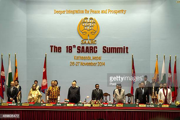 SAARC leaders stand during the inaugural session of the 18th SAARC Summit on November 26 2014 in Kathmandu Nepal Nepal is hosting the 18th South...