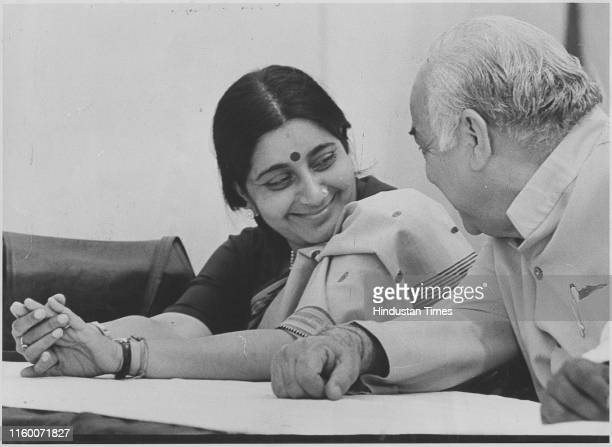 BJP leaders Sushma Swaraj and Madan Lal Khurana talking to each other during a Press Conference at the party office in New Delhi India Former...