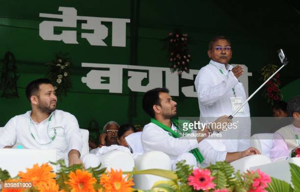 RJD leaders Tejashwi Prasad Yadav and Tej Pratap Yadav at mega rally 'BJP Bhagao Desh Bachao' organised by Rashtriya Janata Dal at Gandhi Maidan on...