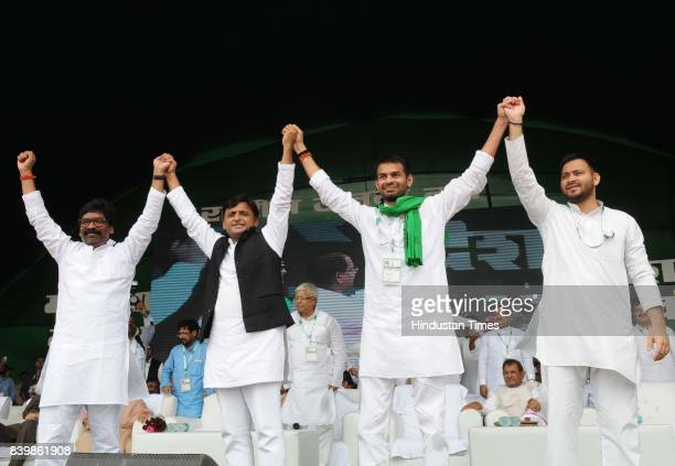 RJD leaders Tejashwi Prasad Yadav Tej Pratap Yadav with SP Chief Akhilesh Yadav and others at mega rally 'BJP Bhagao Desh Bachao' organised by...
