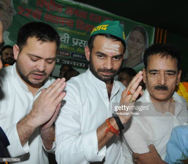 RJD leaders Tejaswi Yadav and Tejpratap Yadav with others at their party foundation day function on July 5 2018 in Patna India Reacting to omission...