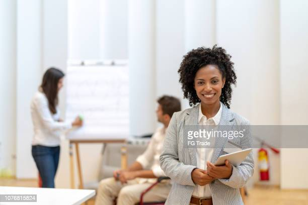 leadership businesswoman portrait at business meeting - differing abilities female business stock pictures, royalty-free photos & images