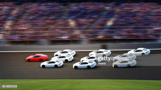 leadership concept. red car is the leader,american stock cars racing in motion on racetrack - nascar stock pictures, royalty-free photos & images