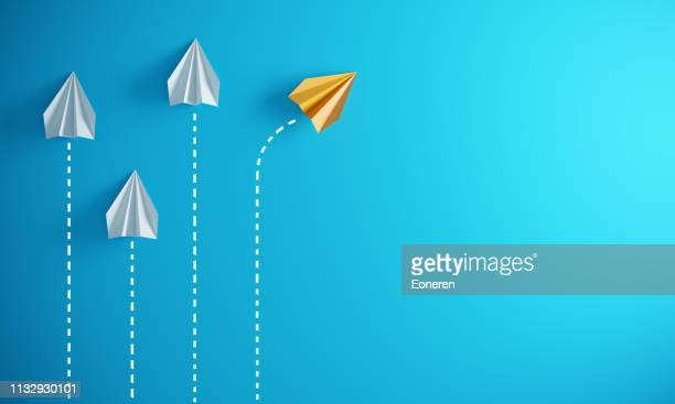 leadership concept with paper airplanes - leaving stock pictures, royalty-free photos & images