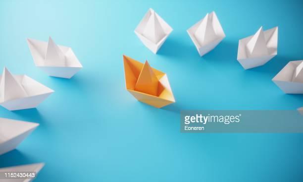 leadership concept with paper boats - origami foto e immagini stock