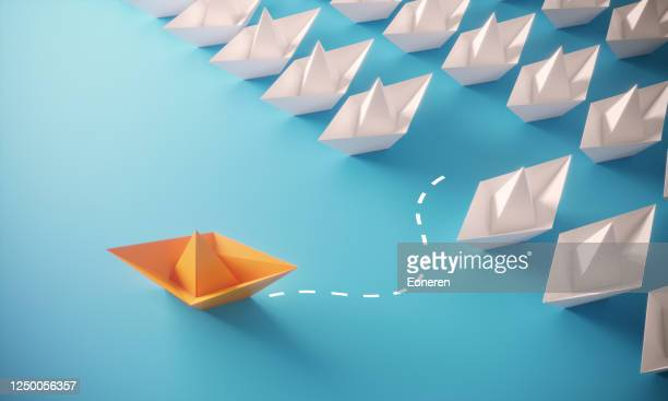 leadership concept with paper boats - leadership stock pictures, royalty-free photos & images