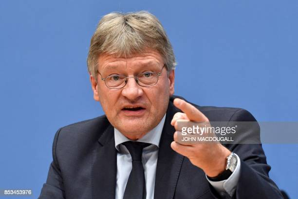 Leadership member of the Alternative for Germany Joerg Meuthen addresses a press conference on the day after the German General elections on...