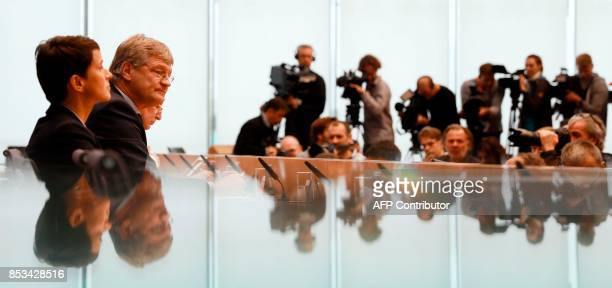 Leadership members of the hardright party AfD Frauke Petry Joerg Meuthen and Alexander Gauland address a press conference on the day after the German...