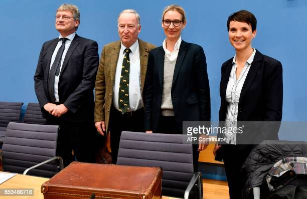 Leadership members of the hardright party AfD Joerg Meuthen Alexander Gauland Alice Weidel and Frauke Petry pose before addressing a press conference...