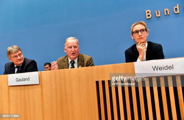 Leadership members of the hardright party AfD Joerg Meuthen Alexander Gauland and Alice Weidel address a press conference on the day after the German...