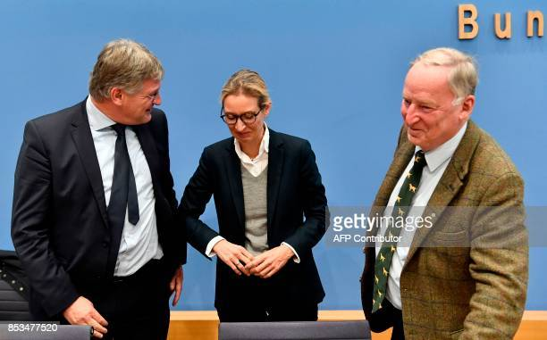 Leadership members of the hardright party AfD Joerg Meuthen Alice Weidel and Alexander Gauland leave after addressing a press conference on the day...