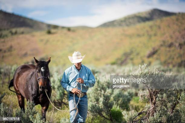 Leading a horse in American wilderness