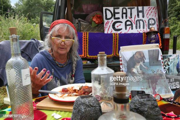 Leading activist and protester, known as Polly, enjoys her vegan breakfast during the demonstration. Animal rights activists occupy Camp Beagle, a...