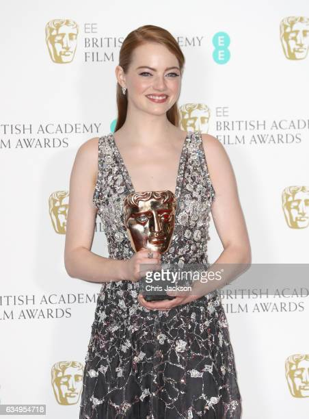 Leading Actress winner Emma Stone poses with her award in the winners room during the 70th EE British Academy Film Awards at Royal Albert Hall on...