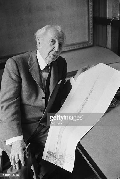 Leading American architect Frank Lloyd Wright holds a sketch of his milehigh office building which would rise 528 stories above Lake Michigan in...