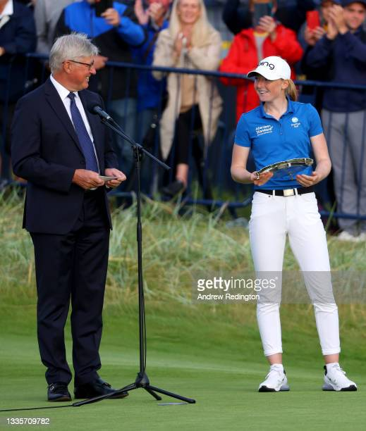 Leading armature, Louise Duncan of Scotland winner of the Silver Salver with Martin Slumbers, Chief Executive of The R&A after the final round of the...