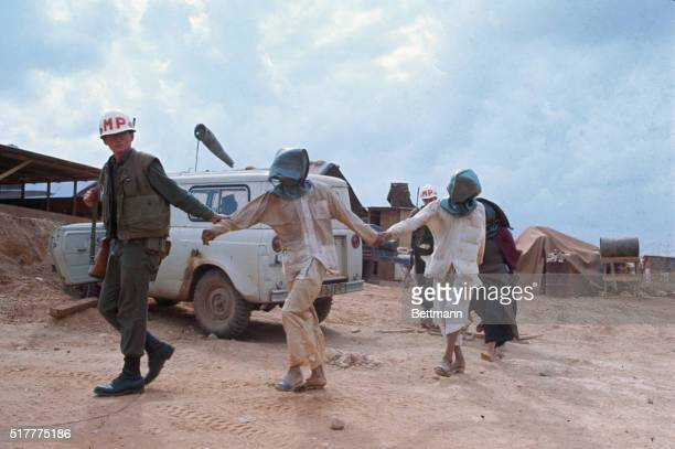MP Leading Captured Viet Cong in Hoods