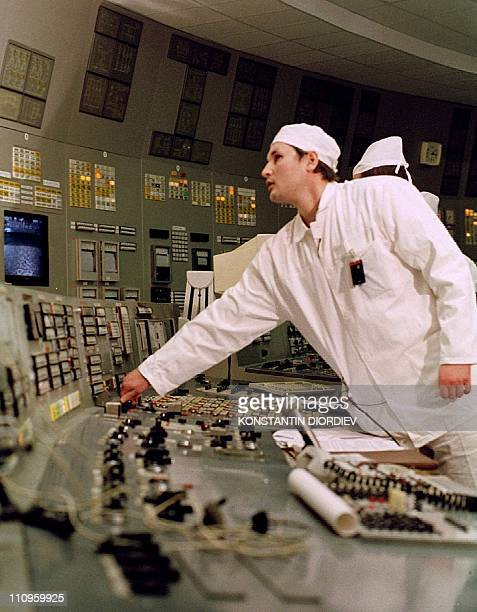 Leading engineer of Chernobyl's nuclear power plant Sergey Bashtovoi turns the key of the emergency stop as he shuts down the plant's third reactor...