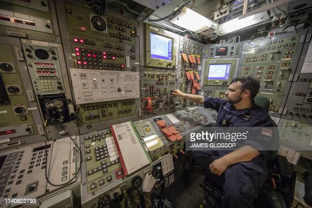 Leading Engineering Technician Chris Randall in the control room onboard Vanguard-class submarine HMS Vigilant, one of the UK's four nuclear...