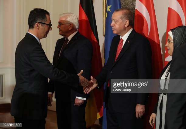 Leading German Greens Party member Cem Ozdemir , an outspoken critic of Erdogan, shakes hand with Turkish President Recep Tayyip Erdogan as Turkish...