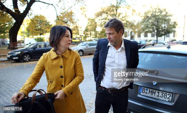Leading German Greens Party members Robert Habeck and Annalena Baerbock arrive for a meeting of the party leadership the day after the Greens came in...
