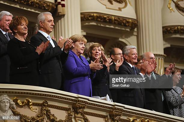 Leading German politicians including German Chancellor Angela Merkel Saxony Governor Stanislaw Tillich and President Joachim Gauck attend...