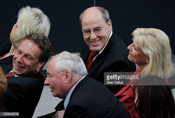 Leading members of the German leftwing Die Linke political party Klaus Ernst Oskar Lafontaine Gregor Gysi and Dagmar Enkelmann attend the election of...