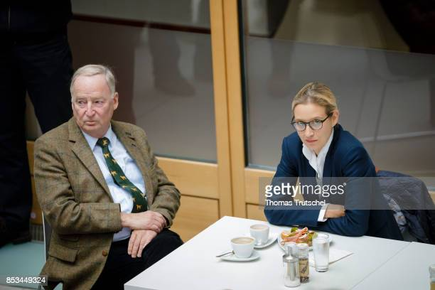 Leading members of the rightwing Alternative for Germany Alexander Gauland and Alice Weidel chats before a press conference on September 25 2017 in...