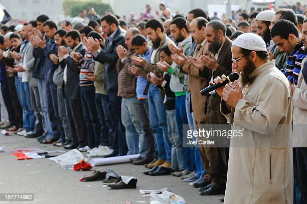 Leading Muslim men in prayer