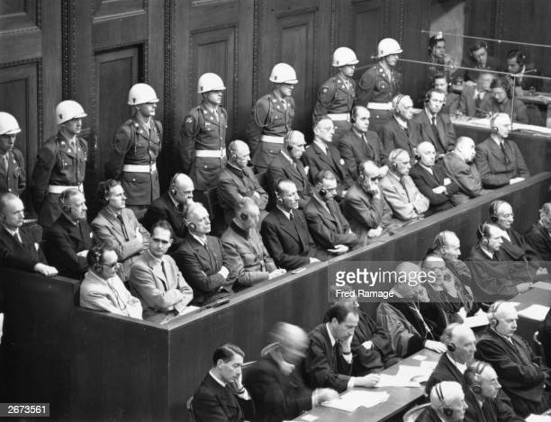 Leading Nazis in the dock in the courtroom at Nuremberg during the final stages of the war crimes trials Front row from left to right Hermann Goering...