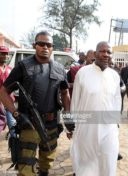 Leading Nigeria comic actor Babatunde Omidina known by the stage name as Baba Suwe accompanied by armed security operatives is lead to courtroom...