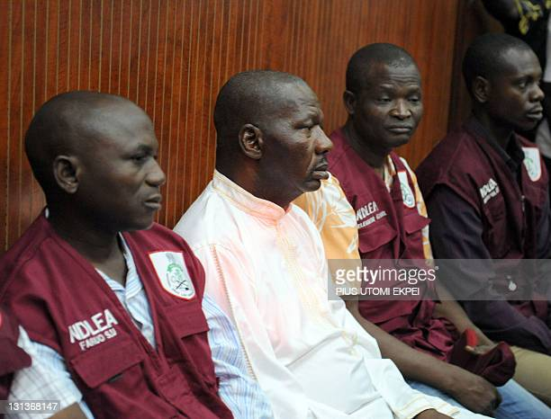 Leading Nigerian comic actor Babatunde Omidina known by his stage name Baba Suwe flanked by members of the drug enforcement agency waits in the...