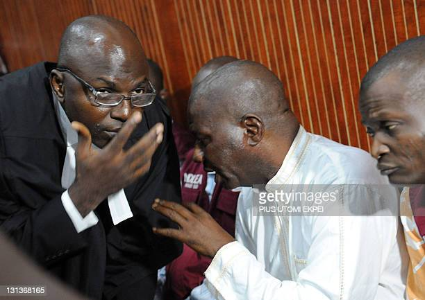 Leading Nigerian comic actor Babatunde Omidina known by his stage name Baba Suwe talks to his lawyer Bamidele Aturu in the courtroom in Lagos on...