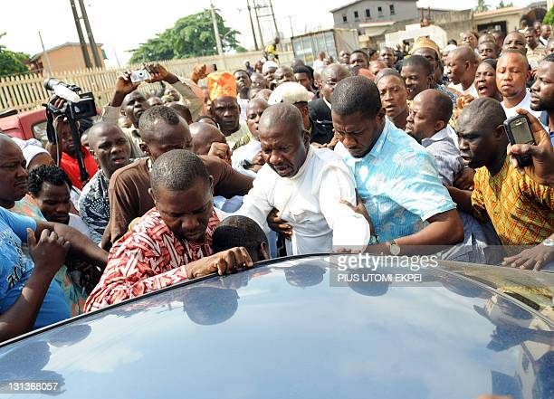 Leading Nigeria's comic actor Babatunde Omidina known by the stage name as Baba Suwe raises his hands after being freed on bail for peddling on hard...