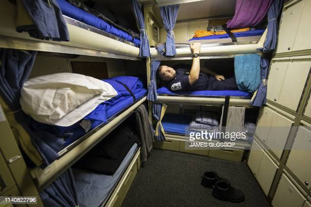 Leading Seaman Darren Richardson in his bunk onboard Vanguardclass submarine HMS Vigilant one of the UK's four nuclear warheadcarrying submarines at...