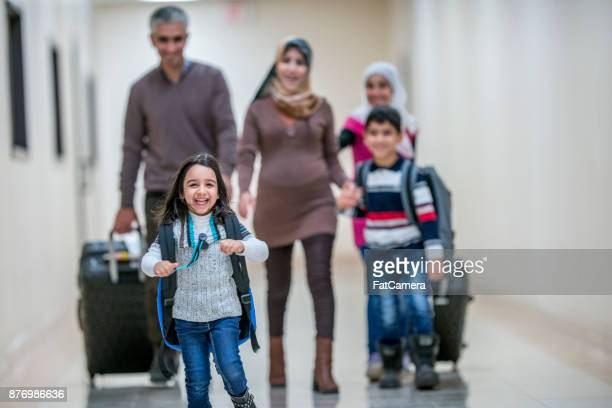 leading the family - emigration and immigration stock pictures, royalty-free photos & images