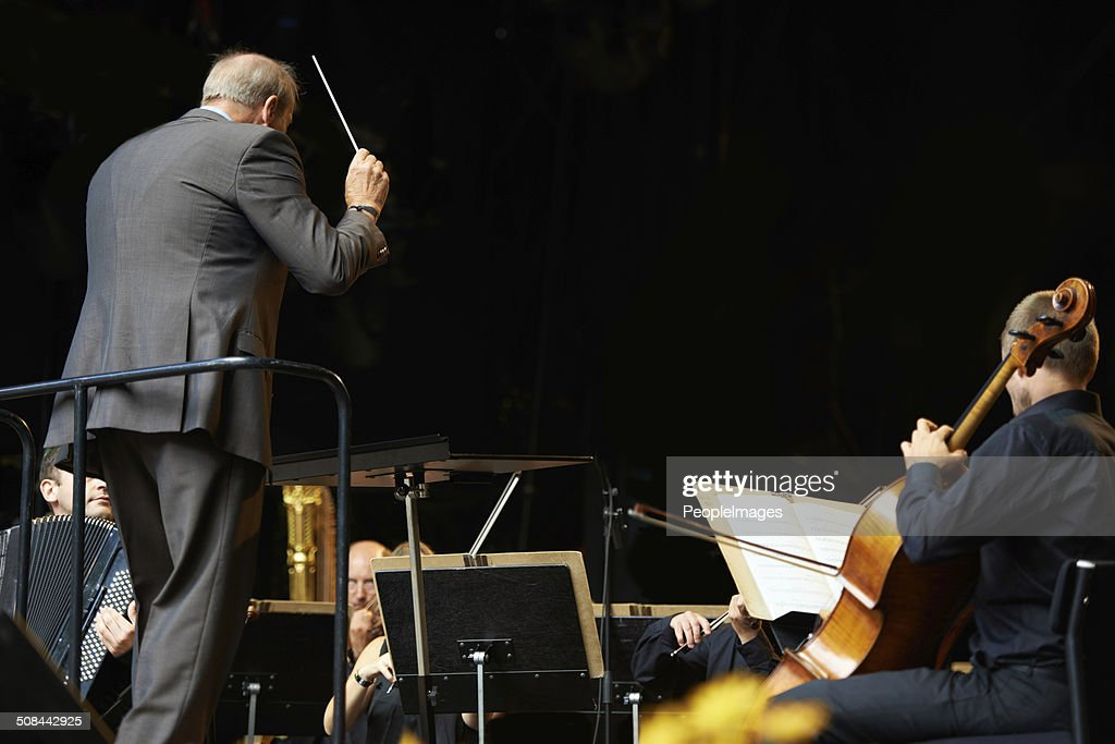 Leading the orchestra in a symphony : Stock Photo