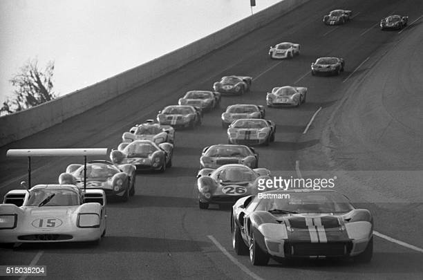 Leading the pack at the start of the 24hour Continental race here February 4th are Phil Hill in Chaparral and AJ Foyt in a Ford Mark II The...