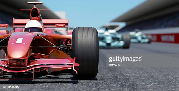 leading the race - grand prix motor racing stock pictures, royalty-free photos & images
